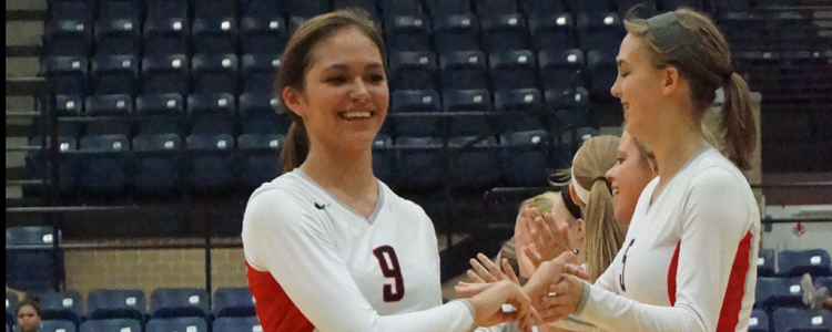 Sophomore Mandy Ramirez gives high fives as her name is called on the loud speaker on Sep. 4.