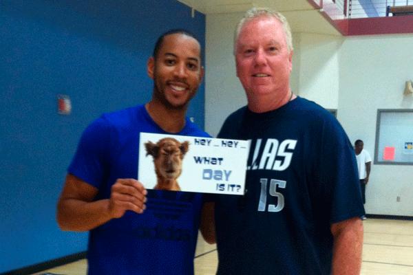 Coach David Geer (right) poses for a photo at a Dallas Maverick basketball camp.