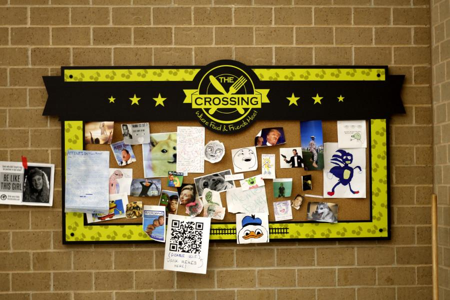 Various+%22memes%22+hang+on+a+board+in+the+cafeteria.