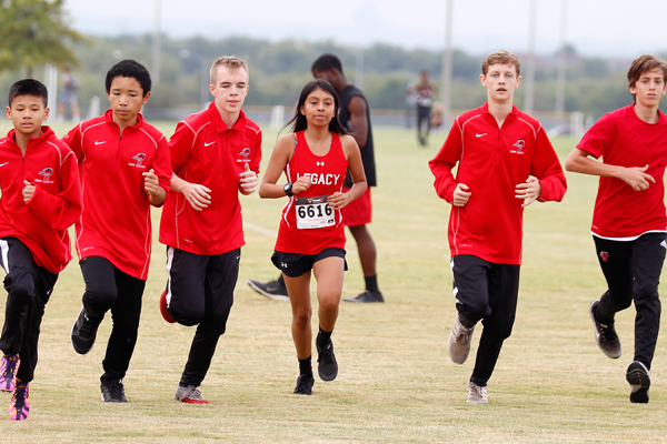 Students warm up before a cross country meet.