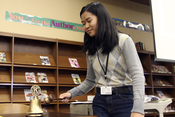 Margaret Vo rings the Key Club bell to start the meeting. (Ellie Brutsche photo)