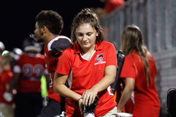 Jillian Wolny stretches a football players leg during the game against Wichita Falls.