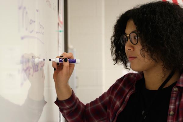 Junior Saella Ware brainstorms project ideas for Enviromental Club.