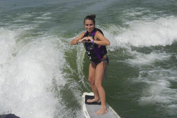 Sophomore Alexis Ouart surfs.