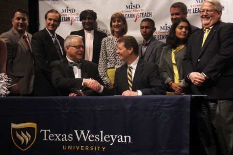 MISD Superintendent Dr. Jim Vaszauskas shakes hands with President of Texas Wesleyan Frederick Slabach.