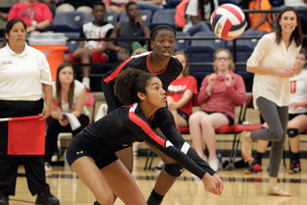 Keslyn King, 10, watches the volleyball as it comes down to hit her arms at the varsity game on Sept. 20.
