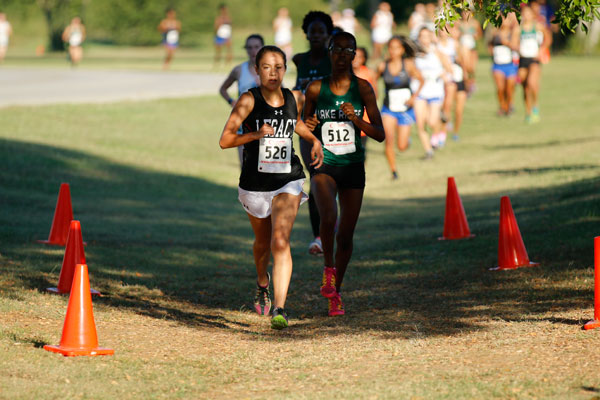 Catherine+Richardson%2C+12%2C+leads+the+varsity+district+cross+country+meet.+Richardson+ended+up+placing+fifth+out+of+all+the+girls+varsity+cross+country+runners+in+the+district.+%28Megan+Bell+photo%29