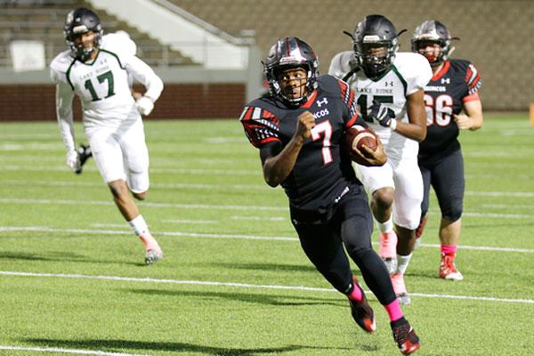 Kendall Catalon #7, 12, rushes for a touchdown against the Lake Ridge Eagles.