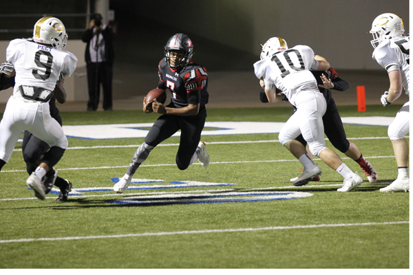 Kendall Catalon, 12, runs the ball in the Legacy vs Cleburne game.