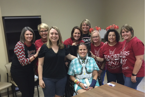 Ms. Marcia Lass, visits with Legacy staff while in recovery. Ms. Lass returned to work after her accident on Nov. 29.