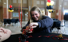 Brooke Bussey sets up for the Bronco Ball hosted by NHS students.