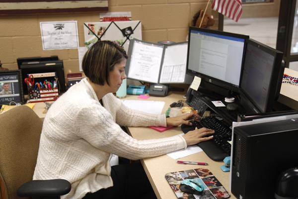 Attendance Clerk Wendy Ruiz works at her computer during her first few weeks at Legacy. Ruiz and other new teachers, secretaries, and administrators join the faculty for the 2017-2018 school year.
