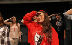 Jisella Ayala, 12, salutes at the theater New Faces meeting.