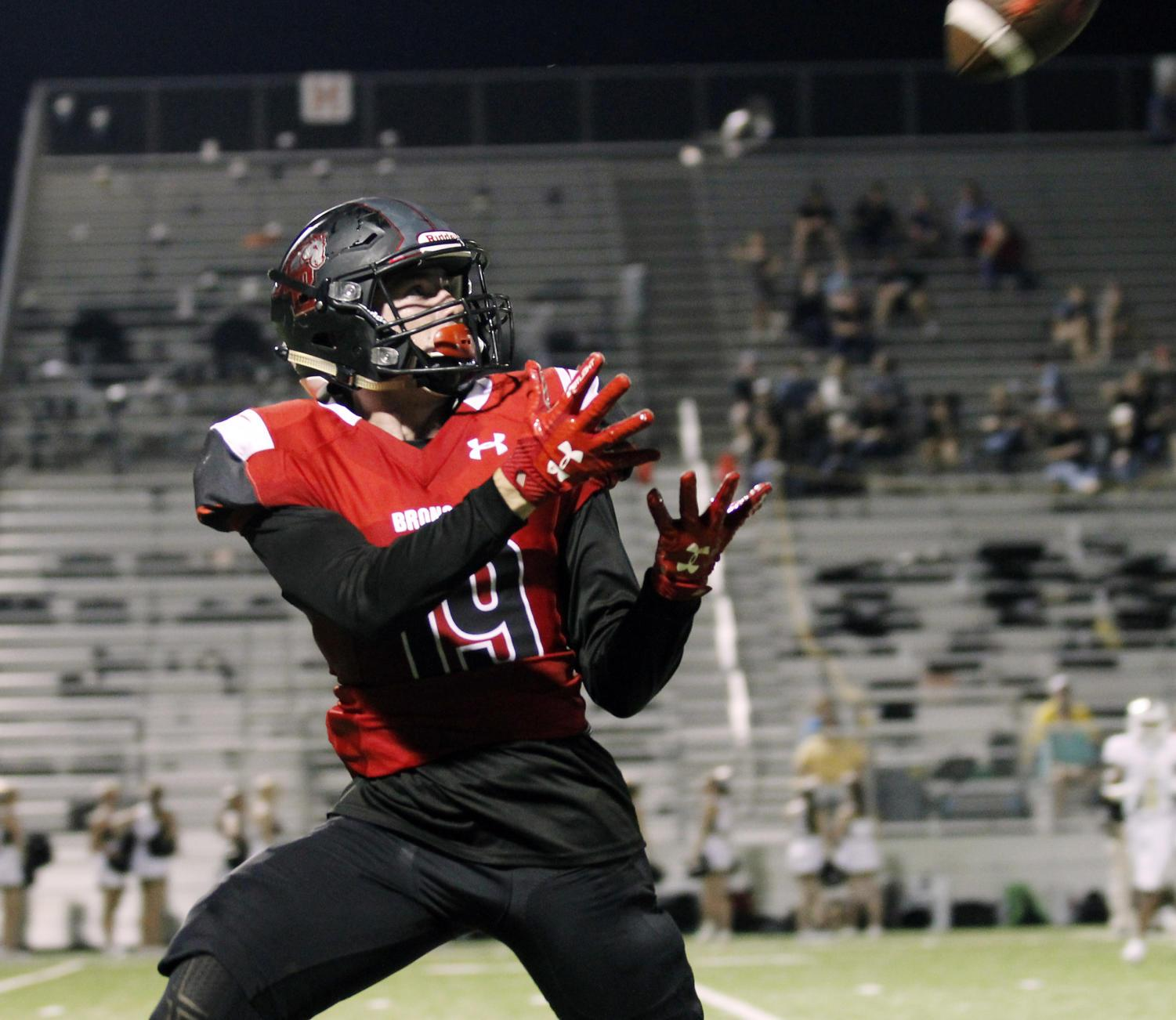 Junior Nathan Rooney receives a pass during the game against Wichita Falls on Friday, Sept. 1.