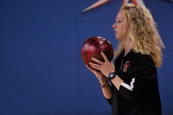 Senior Sadie Johnson prepares to take her swing at the bowling meet on Oct. 5.