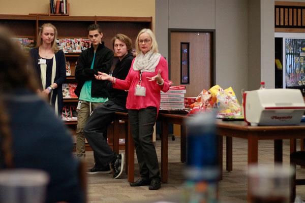 Math teacher and chess club sponsor Ms. Sarah Kamphaus speaks at the Calculus Alumni luncheon.