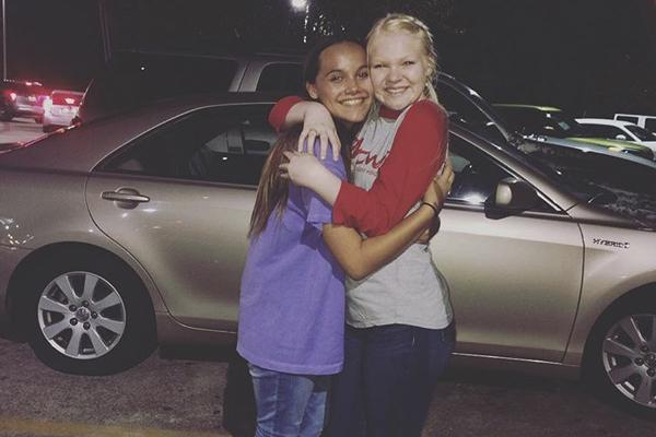 Sophomore Victoria Bledsoe hugs her best friend, Fayth, in their last photo together. This image is engraved onto the necklace Bledsoe now wears daily in remembrance of her friend.