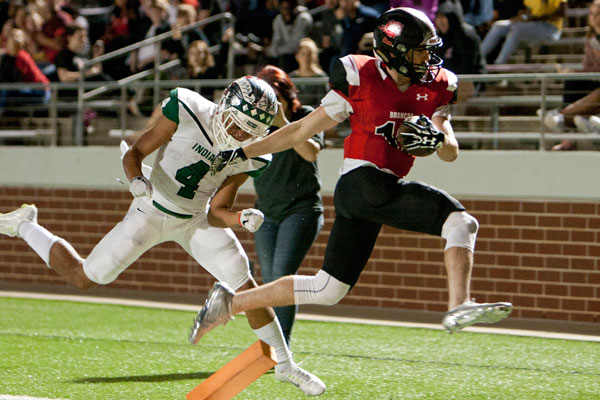 Junior Nathan Rooney scored a touchdown during the varsity football game against Waxahachie on Oct. 20. The Broncos won the game 39-34. Rooney has scored four touchdowns this season.