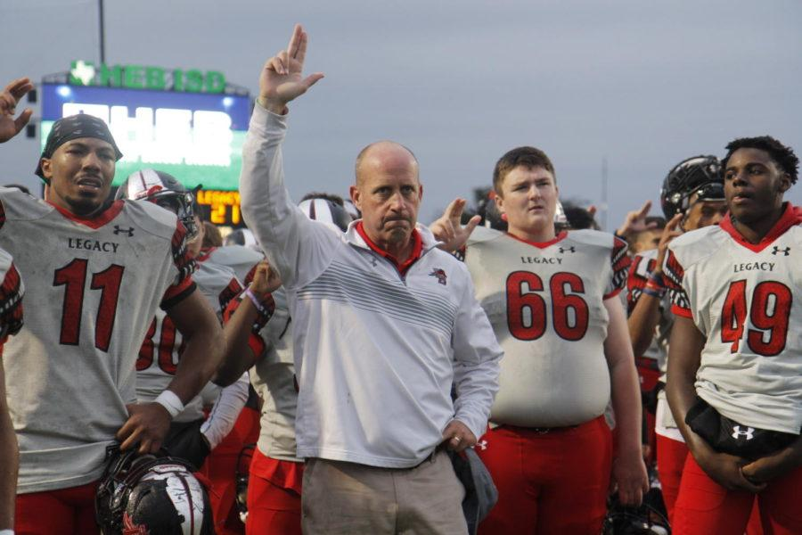 Coach+Chris+Melson+and+his+varsity+football+team+sing+the+Legacy+fight+song+after+the+loss+against+Aledo.+Legacy+in+the+semi-final+round.+%28Tori+Greene+photo%29