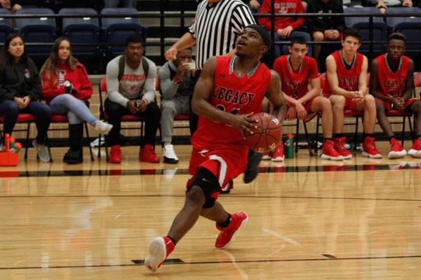 Trevone Fuller, 12, plays in the Spring Creek Basketball Tournament on Nov. 30.