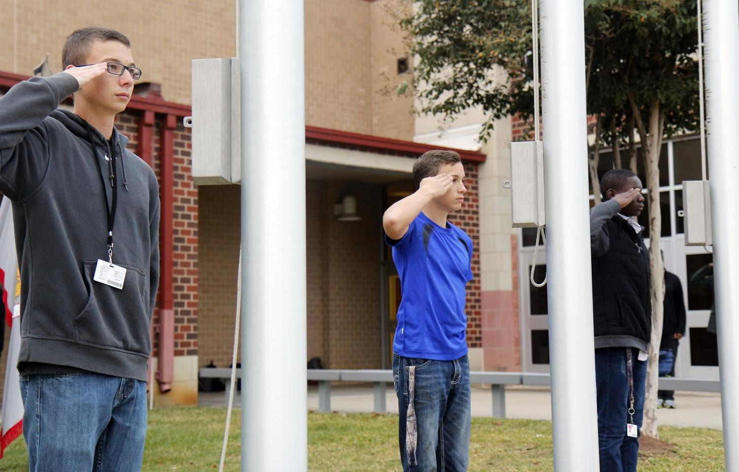 Junior Caleb Finger stands in line with fellow JROTC members during practice.