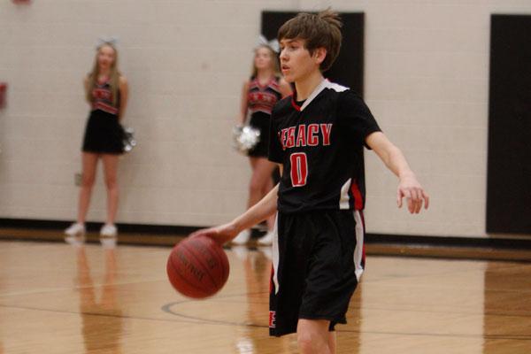 Eli Riley, 9, takes the ball down the court during the freshmen A basketball match against Lake Ridge on Jan. 12.