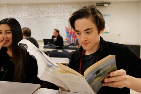Senior Nathan Haslam reads the novel, Heart of Darkness in AcaDec.