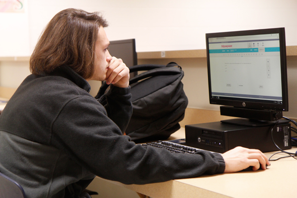 Thomas Stalnaker, 12, works in Online Credit Recovery.