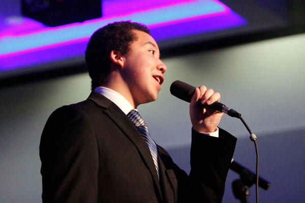 Senior Alex Vo sings during band's annual Jazz Bash