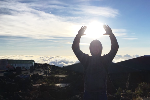 Senior Ryan King holds up the sun during his summer vacation to Hawaii. Many students spent their vacations relaxing, spending time with family and doing new things.  Courtesy Photo