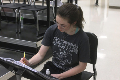Brittyn Sutton, 12, practices her All State music.