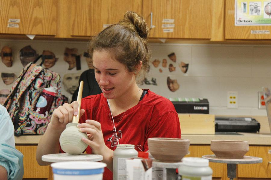 Junior Maggie Brutsche works on her ceramics project in Art. Brutsche and other art students participated in VASE competition, and advanced to state.