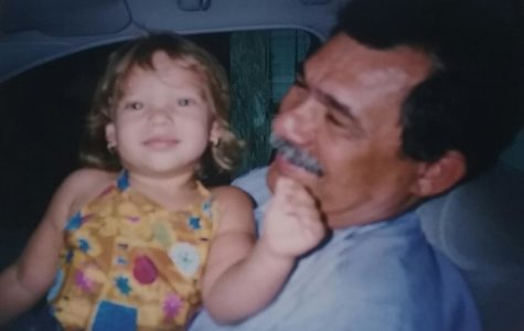 Senior Victoria Rodriguez and her grandfather posing for a photo before she moved to Florida.