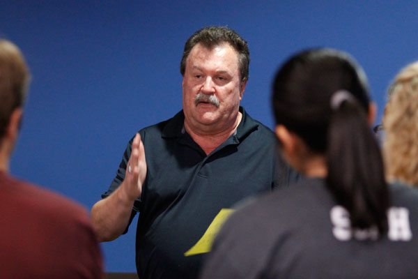 Coach Mike Young talks to prospective bowlers during try outs on Oct. 5. The Boys' varsity bowling team place second at the regional round and qualified for state.