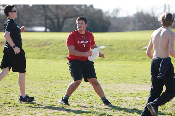 Jake Stacks, 12, searches for a teammate to pass the frisbee to during the Ultimate Frisbee Club's first match that took place on Mar. 2.