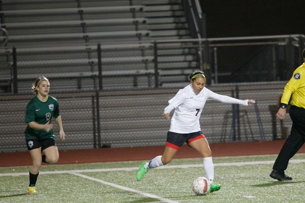 Dezaire Rodriguez, 12, draws her leg back and prepares to kick the ball. Girls' Soccer will face Crowley in the first round on March 29 at 6 p.m.