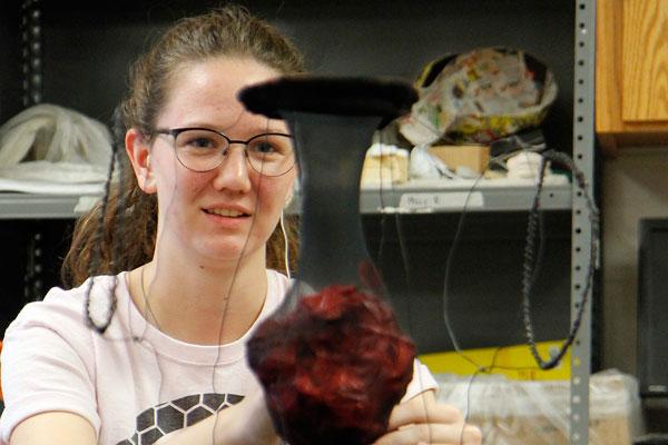 Senior Emma Randall creates a sculpture during Art class.