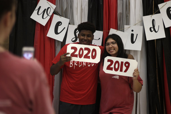At the Legacy's annual Westside Picnic, Lexus Ramos, 11, and Michael Cooper, 10 pose in front of a photo booth made by the student council. The picnic encourage community among all of Legacy's feeder schools.