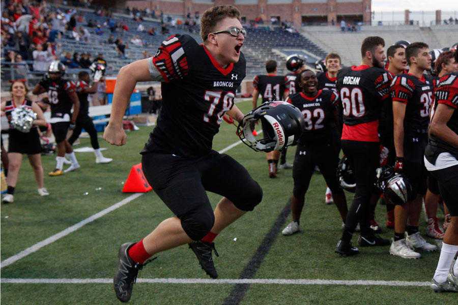 Cameron Chlup, 12, celebrates after the Broncos win against North Forney in the third round of playoffs.