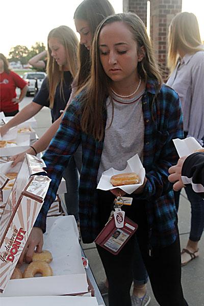 Kayla Stayton, 12, grabs a donut at Senior Sunrise. (Delayne Fierro photo)
