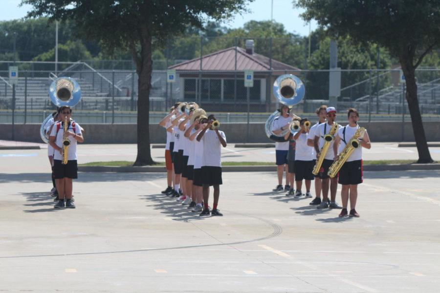 Bronco band members rehearse for their upcoming show during the summer.