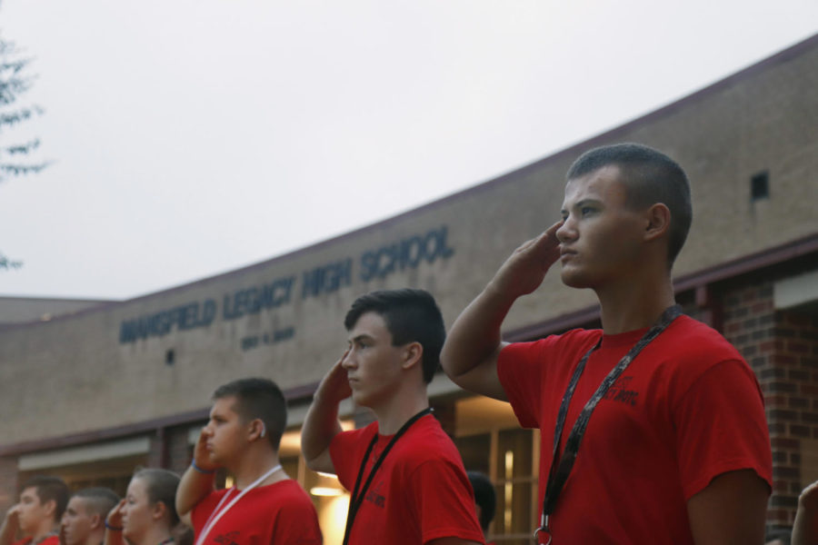 Along+with+the+JROTC+team%2C+Alex+Sims%2C+11+salutes+at+the+on+9%2F11+flag+ceremony.+
