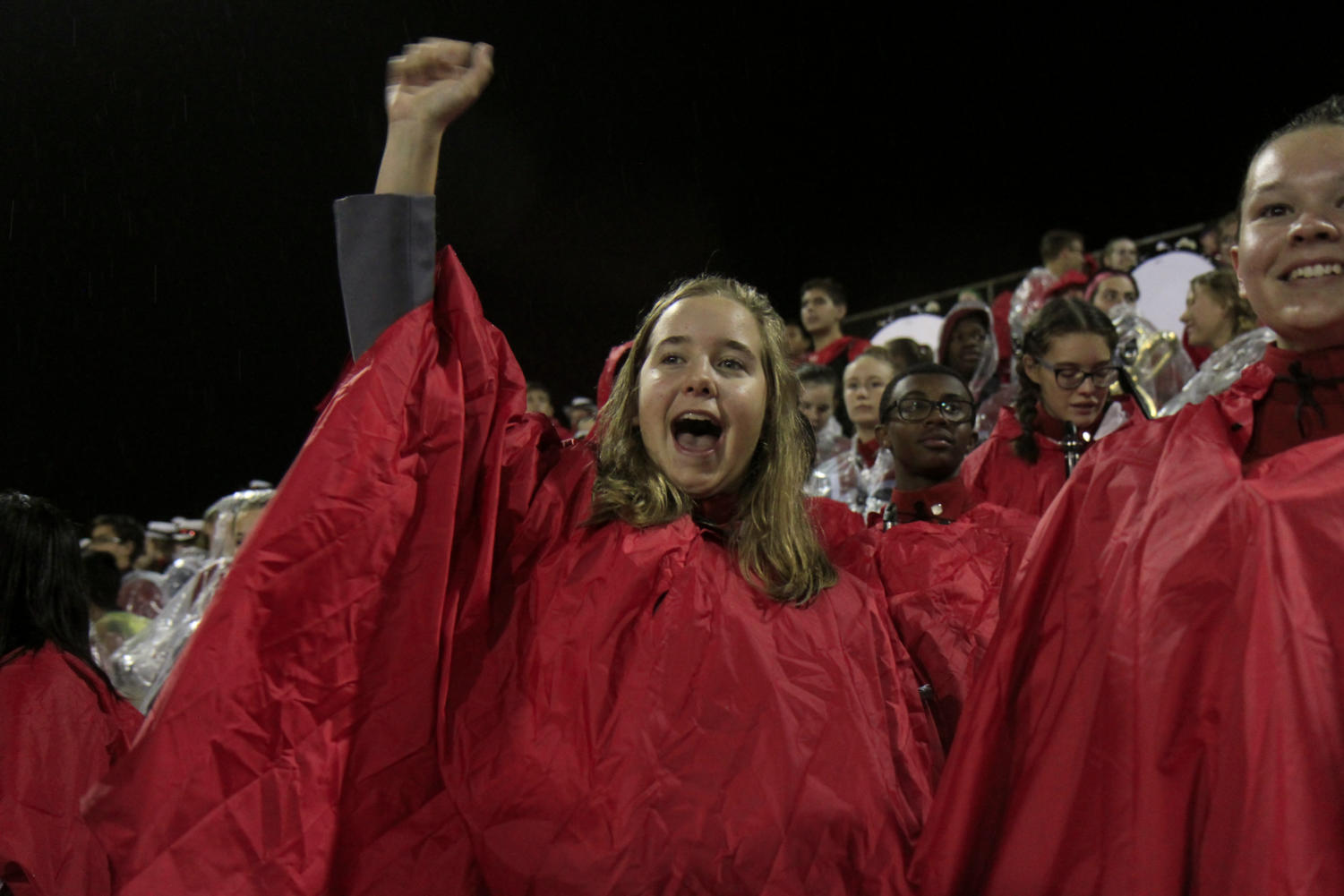 Wearing a poncho, Sydney Shannon, 10, cheers with the band for the Legacy football team in the stands. Band was unable to preform because of rain. Legacy beat Woodrow Wilson 42-6 on Oct. 19.