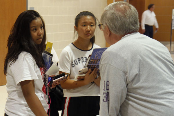 At the 2017 college and career night, Leah Nguyen, 11, and Yunah Song, 11, speak to a college representative. The 2018 college and career night event is scheduled for Oct. 29.