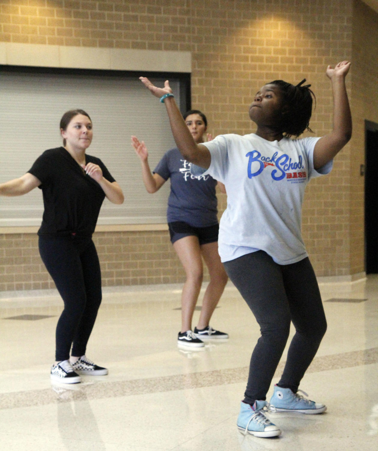 The capitan of the Step team, Amara Shanks teaches the girls the first and second lieutenant tryout step routine.