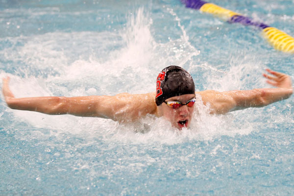 Eric Stelmar, 11, competes at a swimming meet