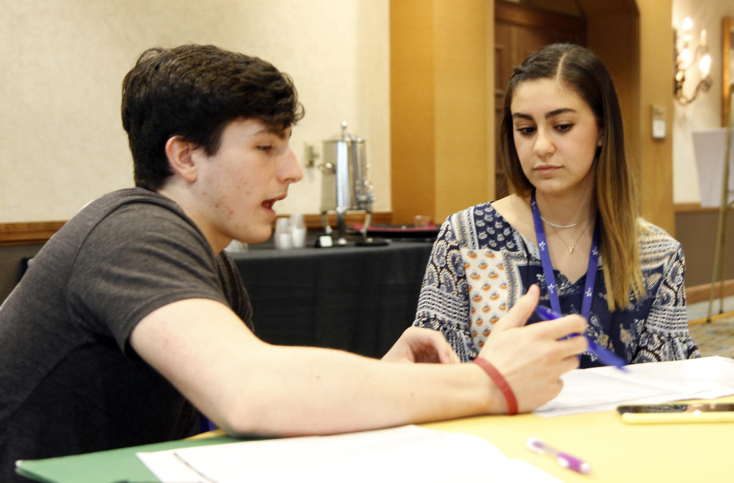 Fernanda Kurrie and Luke Kerr  discuss the classes at the TAJE convention in San Antonio. Several of the leaders and sponsors of New Voices are present at the convention.