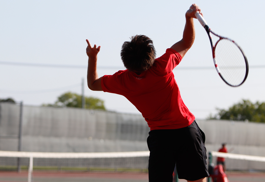 Mason Callaway, 12, swings his racquet at the tennis ball