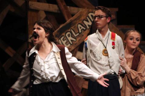 Katy Thomas and Andrew Bates, 12, perform