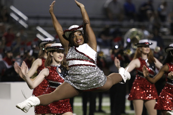 Eboni Kinnel, 11, leaps during her performance with drill team at the varsity football game on Sept. 28.